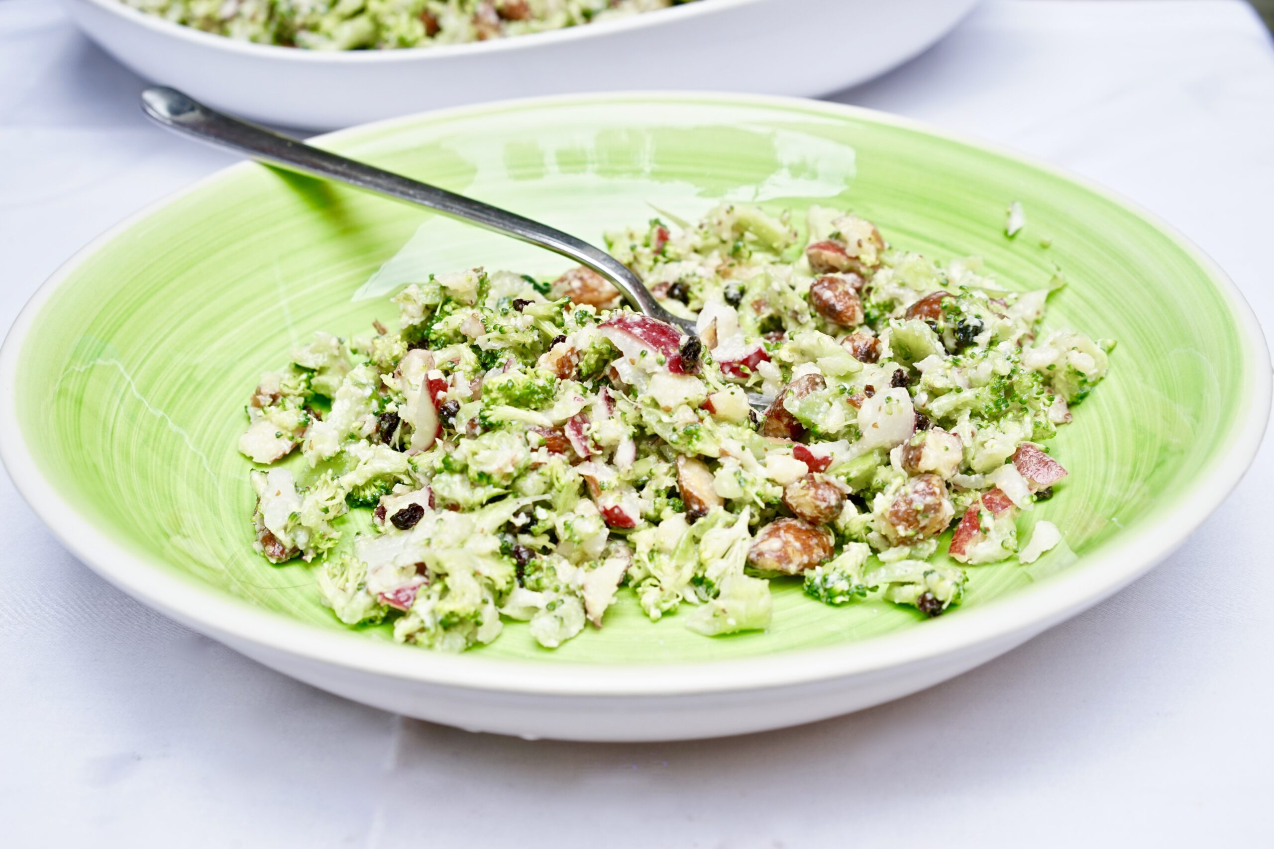 Riced Broccoli Salad with Almonds, Currants, and Gouda Dressing